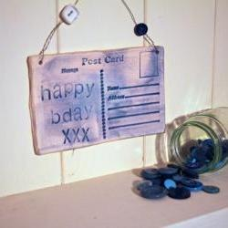 Ceramic Birthday Postcard. Lightly glazed in blue. Handmade made in Wales, UK